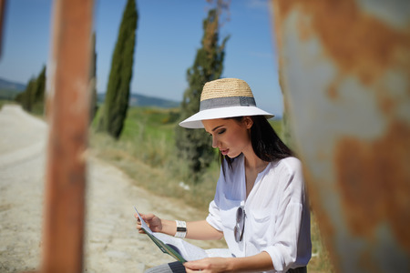 beautiful hat woman holding paper map finding right tourist route Stock Photo