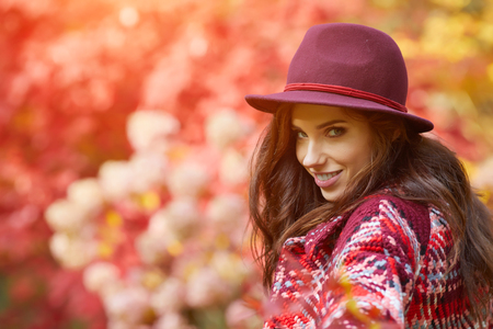 Beautiful elegant woman standing in a park in autumn , Fall concept photo