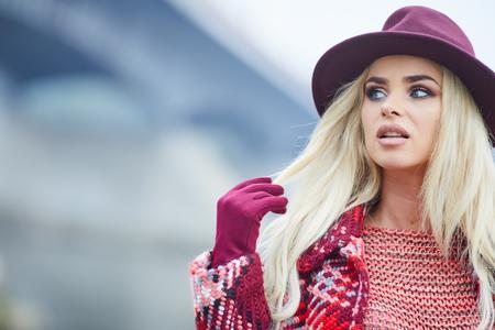 winter fashion: Beautiful blonde woman portrait in autumn city