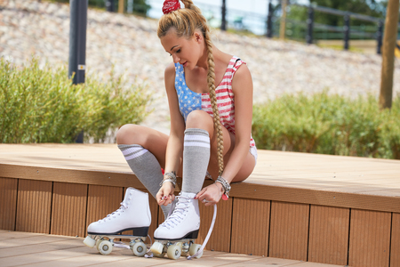 beautiful young blond woman with  roller skates.