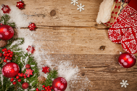 Christmas wooden background with snow fir tree and gift boxes. View with copy space Stock Photo