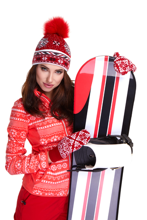 Woman wearing winter suit holding a snowboard in studio Stock Photo