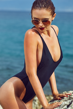 Sexy young woman relaxing on the beach