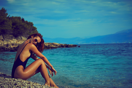 summer sunny fashion portrait of pretty young sensual redhair woman posing in bikini Archivio Fotografico - 94134680