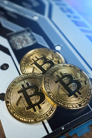 Bitcoin and Graphic Card in background