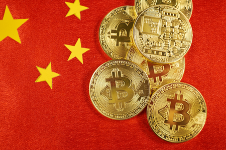 Golden bitcoin and Chinese flag on background Stock Photo