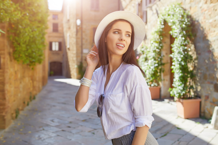 Young tourist walks in the old town