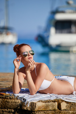 Beautiful and sporty body of sexy woman over the summer background Stock Photo