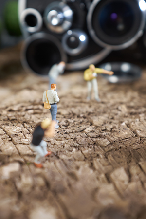 Miniature people photographer : shooting  a Retro, old, vintage and classic film camera
