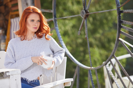 Outdoors autumn portrait of beautiful woman with red hair Фото со стока