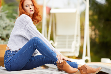 Outdoors autumn portrait of beautiful woman with red hair Stock Photo