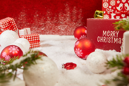 Christmas background. Red Christmas box on a red background. Greeting Christmas card. Stock Photo