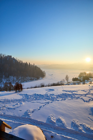 Snow covered trees in the mountains at sunset. Beautiful winter landscape. Winter forest. Stock Photo