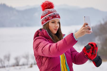 woman take a photo at viewpoint