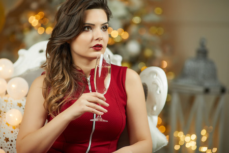 Smiling Woman Holding Glass Of Sparkling Wine Stock Photo