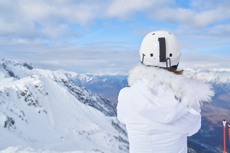 Woman skiers on snowy mountain enjoying landscape. View of back. Woman skiers standing on snowy mountain 版權商用圖片