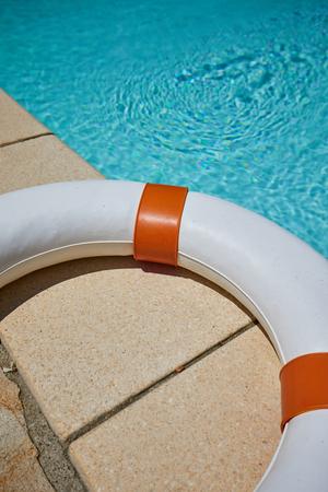 Lifebuoy at the edge of swimming pool.