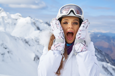 Excited Woman Laughing In The Mountain Stock Photo