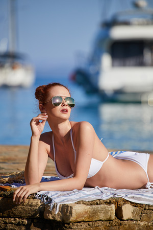 woman with sunglasses of marina on hot summer day