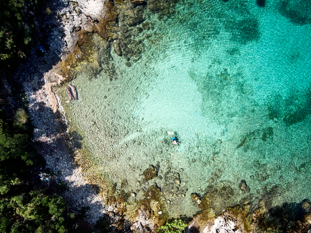 top view of rocky shore crystal clear Adriatic Sea, drone shot Imagens