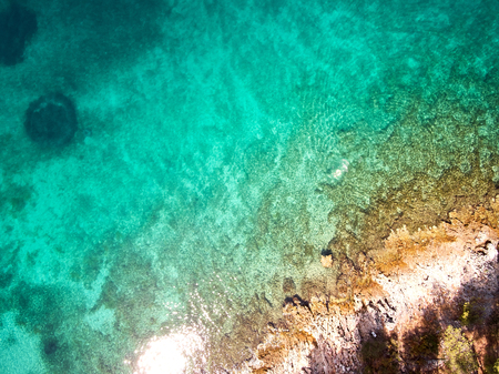 top view of rocky shore crystal clear Adriatic Sea, drone shot Stockfoto