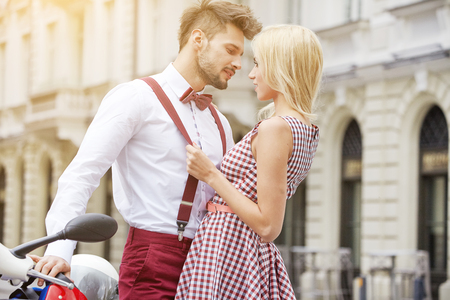 Young couple kissing each other on the street Stock Photo