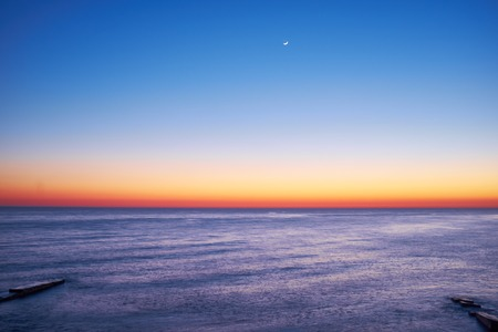 Nice sunset on the beach of the Black Sea 스톡 콘텐츠