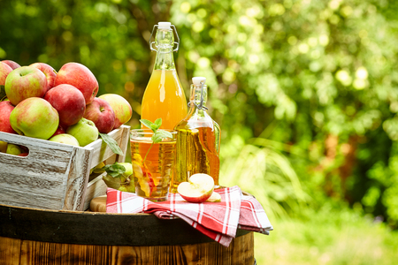 apples on background orchard standing on a barrel. Apple juice and apple preserves. Stok Fotoğraf