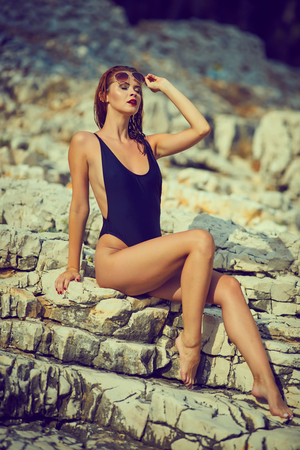 Beautiful woman posing on the beach. In Croatia