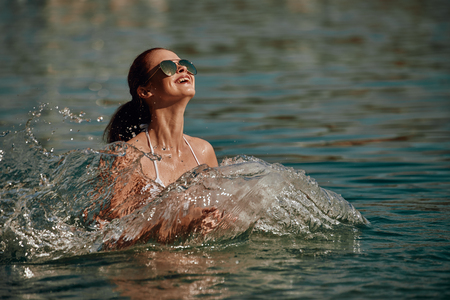 Vintage Bikini girl on the beach. woman in bikini on the beach on Adriatic Sea Imagens