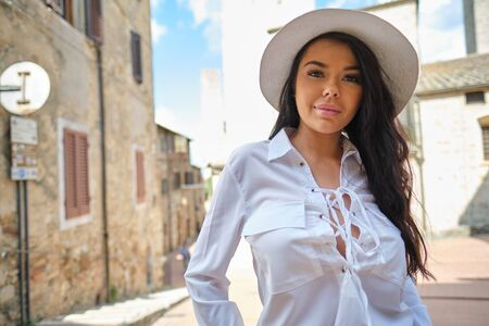 fashion italian woman outdoor on the street of the old town Stock Photo - 124956890