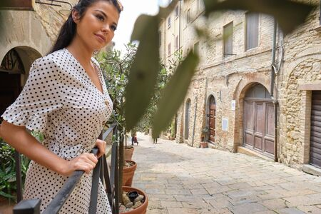 fashion italian woman outdoor on the street of the old town Stock Photo - 124956891