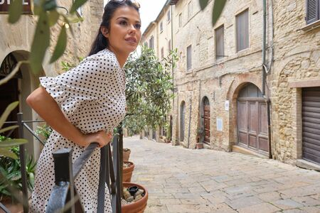 fashion italian woman outdoor on the street of the old town Stock Photo - 124956897
