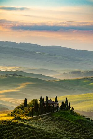Tuscany landscape at sunrise. Typical for the region tuscan farm Stock Photo