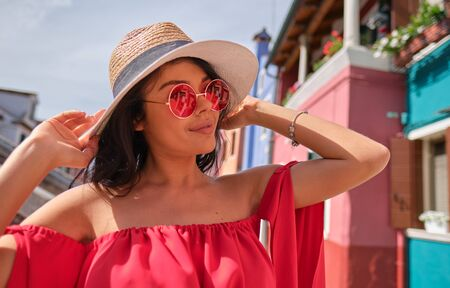 traveler woman posing among colorful houses on Burano island, Venice. Tourism in Italy concept Reklamní fotografie