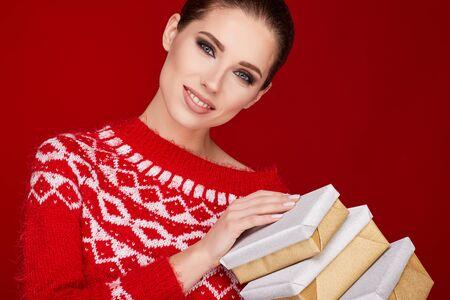 Woman with christmas box gift Foto de archivo