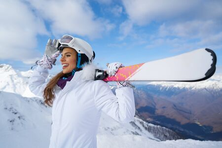 Young caucasian woman skier . Winter sports and leasure activities
