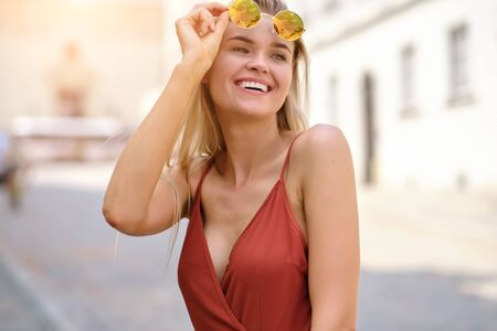 gorgeous beautiful woman in summer  dress and  hat walking.  Portrait of happy girl in the morning outdoors