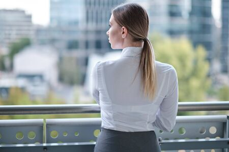 Young businesswoman (real estate agent) presenting detached modern office Stock Photo