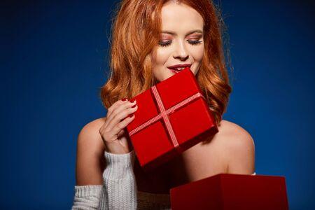 Woman with christmas box gift Stock fotó
