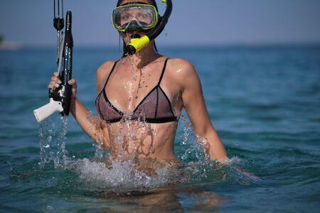 Aqua woman diver spearfishing gun.