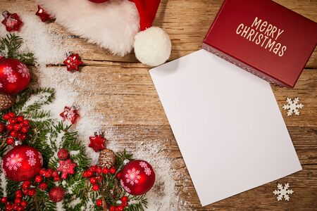 letter to santa claus with christmas colorful decoration on wood table  Stock Photo