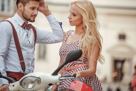 Romantic couple with motorcycle. Loving couple riding on motor in the city.