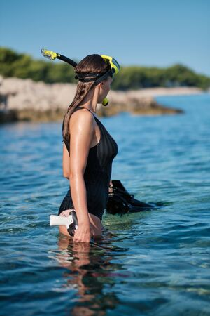Sexy underwater hunter woman