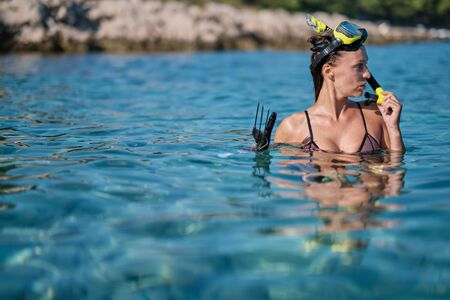 Sexy underwater hunter woman
