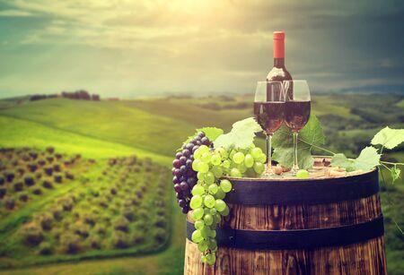 red wine bottle and wine glass on wodden barrel Foto de archivo