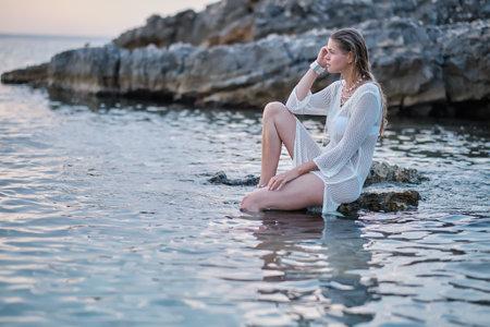 A woman on a rocky beach in Croatia.