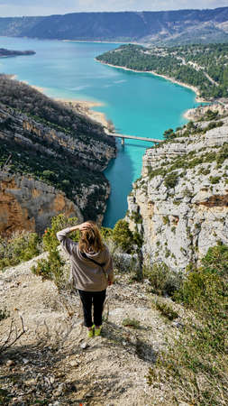 Woman View on Guadalest water reservoir with turquoise water in Alicante province Spain