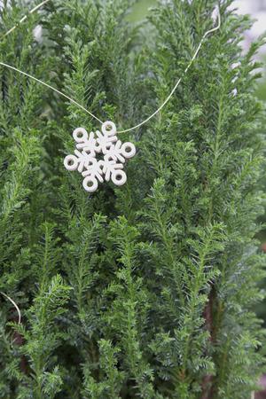 fake christmas tree: Miniature Christmas Tree with Snowflake Garland