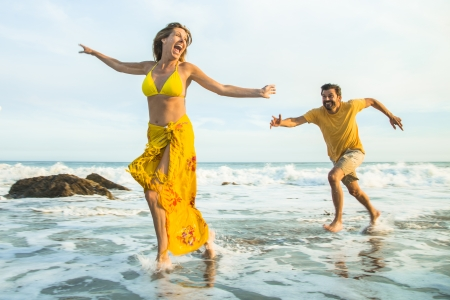 Man chasing woman at the beach